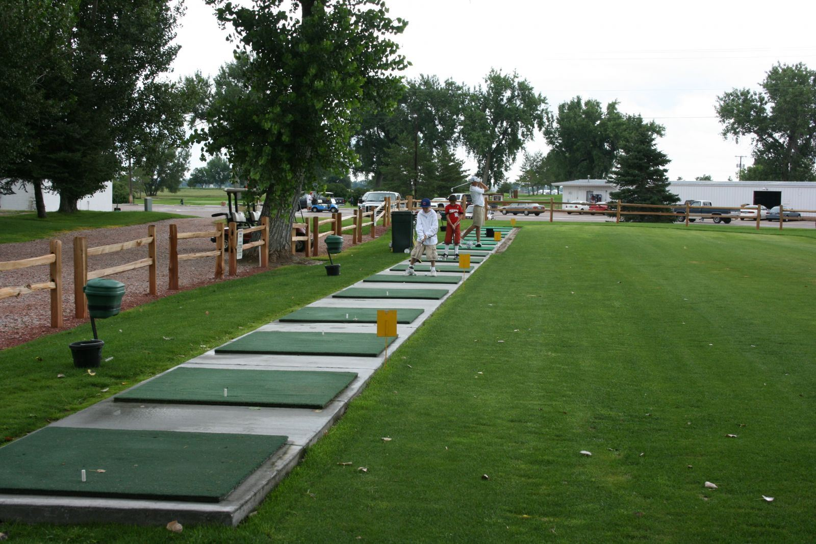 People at Driving Range - Students taking lesson may choose to hit from mats or from grass.